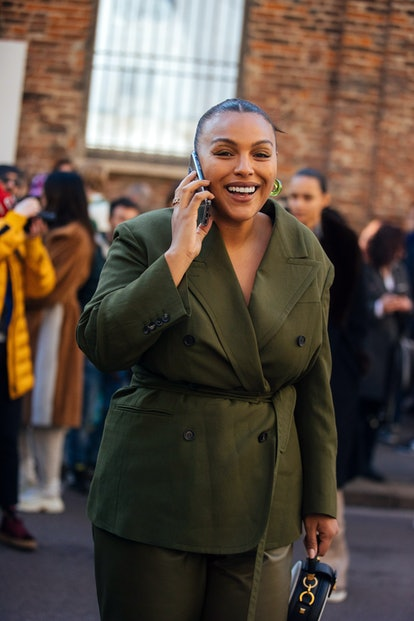 Paloma Elsesser poses in a green suit