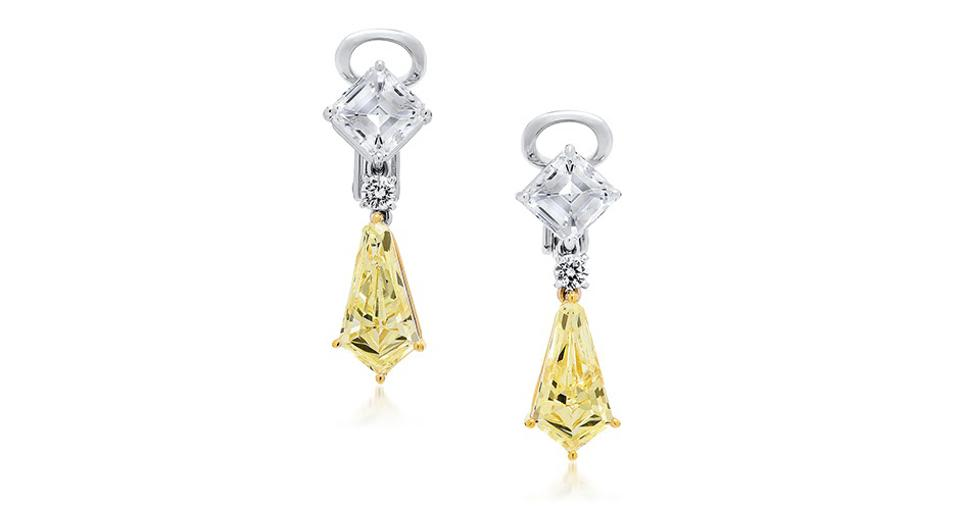These earrings feature kite-shaped yellow diamonds
