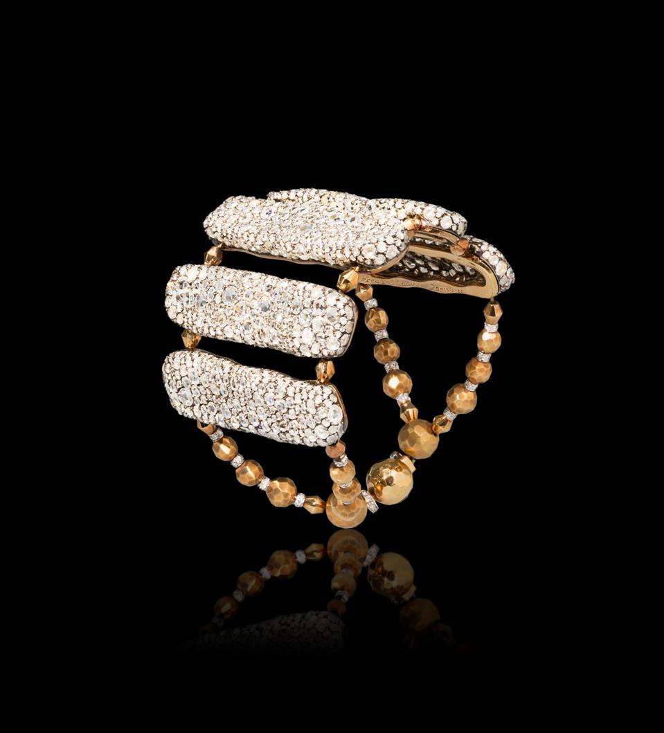Diamond-encrusted, 18-karat gold ″Amazone″ bracelet designed by Frédéric Zaavy.