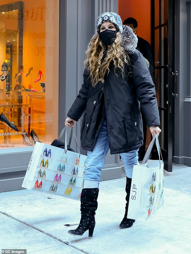 Shopping splurge? The actress, 55, whose character was known for her designer shopping habit, was spotted browsing the shop, before leaving the Midtown, Manhattan, store on with two carrier bags full of goods in her hands