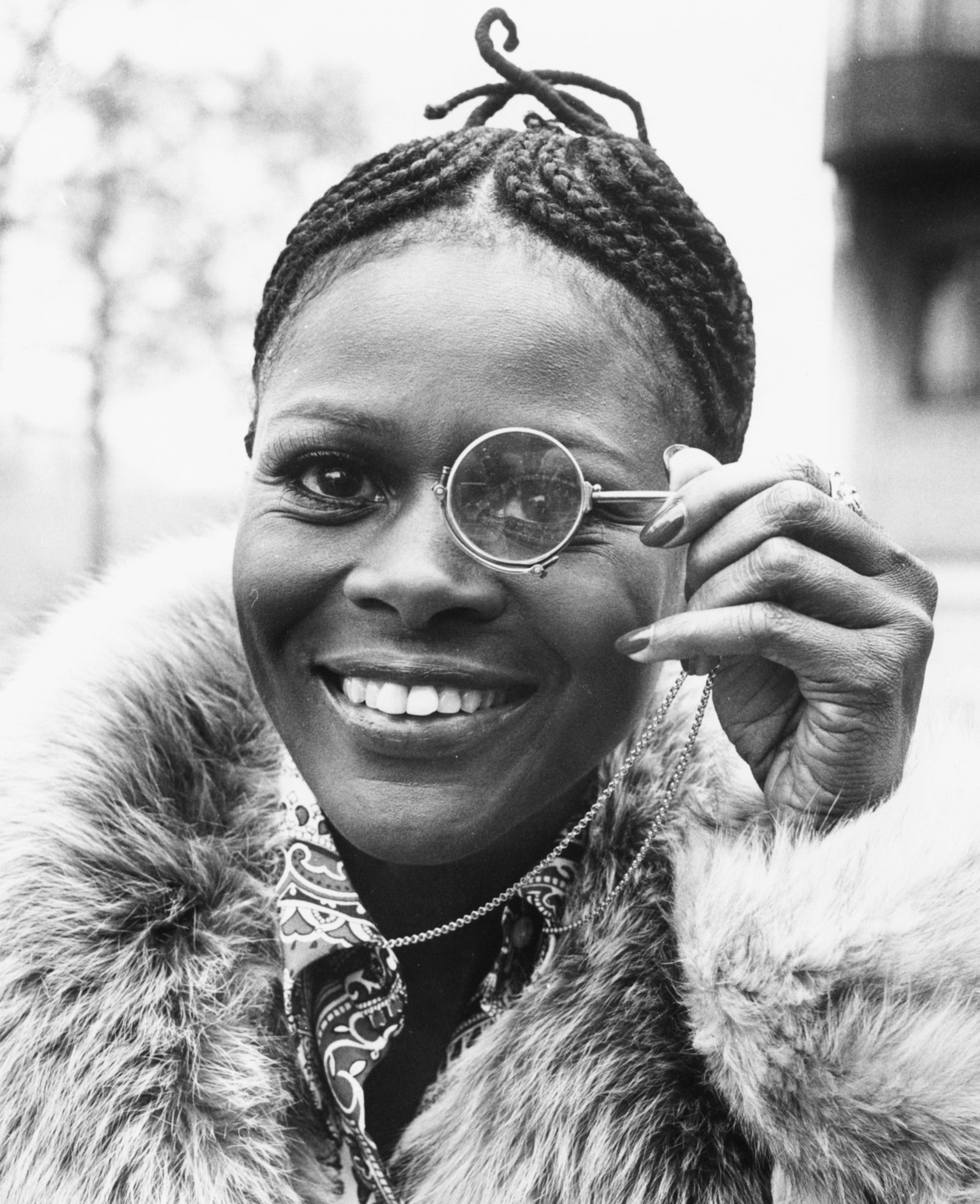 Portrait of American actor Cicely Tyson holding a monocle to her eye during a visit to London February 19 1973.