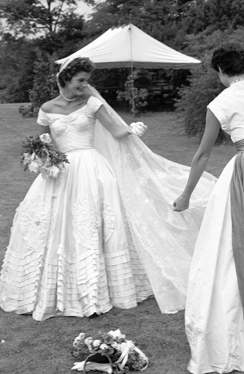 socialite jacqueline bouvier fixing veil of wedding dress outdoors at hammersmith farm on day of her marriage to sen john kennedy  photo by lisa larsenthe life picture collection via getty images