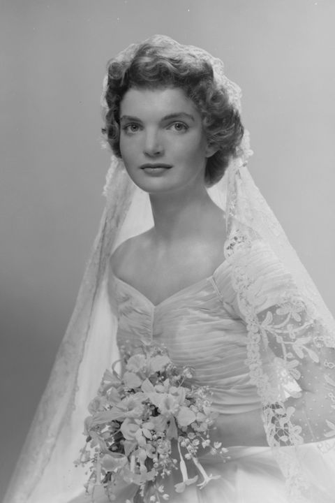 bridal portrait of jacqueline lee bouvier 1929   1994 shows her in an anne lowe designed wedding dress, a bouquet of flowers in her hands, new york, new york, 1953 photo by bachrachgetty images