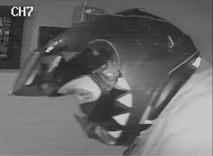 COURTESY HPD                                 Suspect in jewelry store robbery is unknown male with dark helmet and dark clothing.