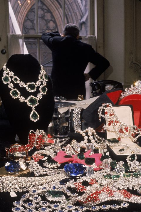 american jeweller harry winston 1896   1978 looks out of his window at st patricks cathedral prior to moving his store to a new location, new york, new york, 1960 the jewels displayed on the black velvet in the foreground are worth over 10m incl the emerald and diamond necklace top l worth 275k the ruby necklace directly below worth 225k the 332 ct sapphire c worth 250k and the diamond tiara top r worth 1m the 332 ct sapphire once belonged to catherine the great photo by  walter sandersgetty images