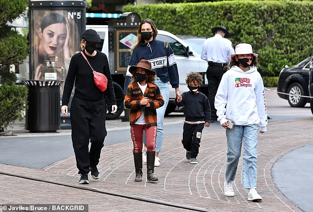In good company:The 51-year-old Grey's Anatomy star was joined on her midday shopping trip by all three of her children, as well as a female friend