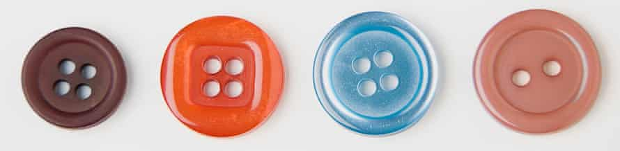 Close up of four buttons against white background