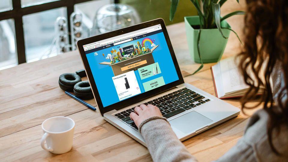 girl browsing Amazon Prime Day on laptop