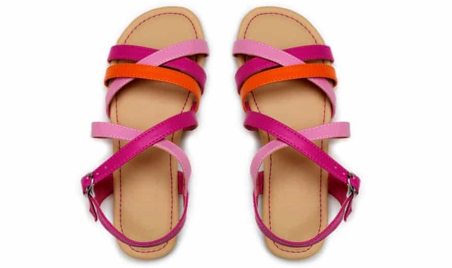Pink and orange sandals against a white background