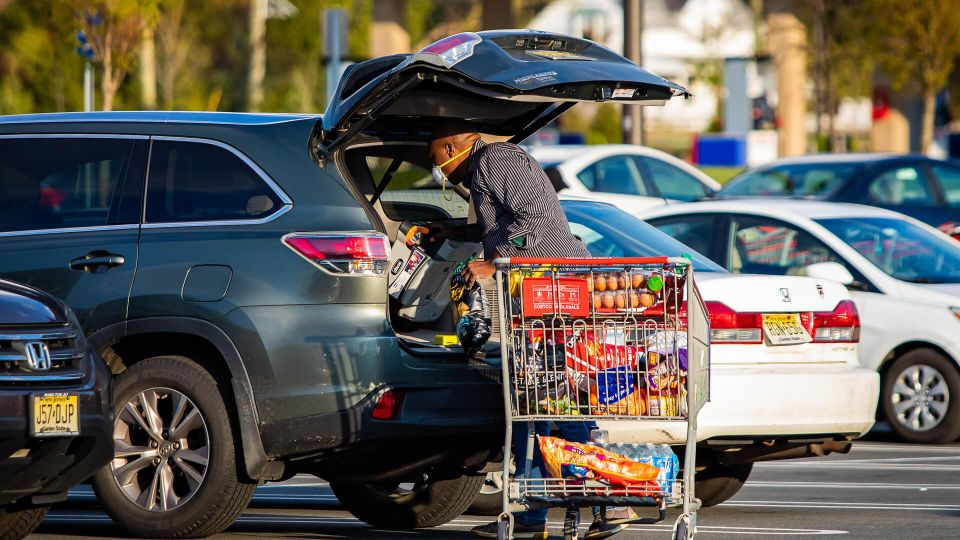 man with full costco cart