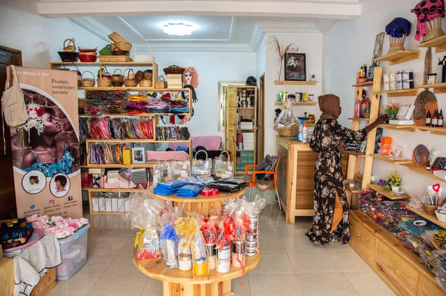 Alimatou Sadiya, manager of Afro Feewi in Dakar, Senegal, organises the store's handmade and organic products, April 2021