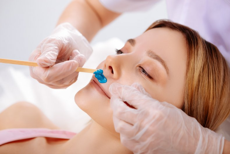 Stock image of a woman getting waxed