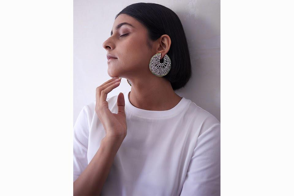 These earrings show a different approach to hoop earrings