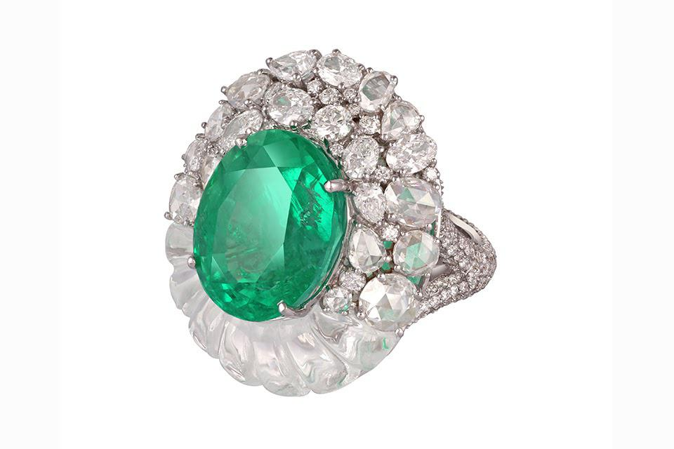 This stunning ring features a 15-carat emerald in an unusual diamond and quartz setting