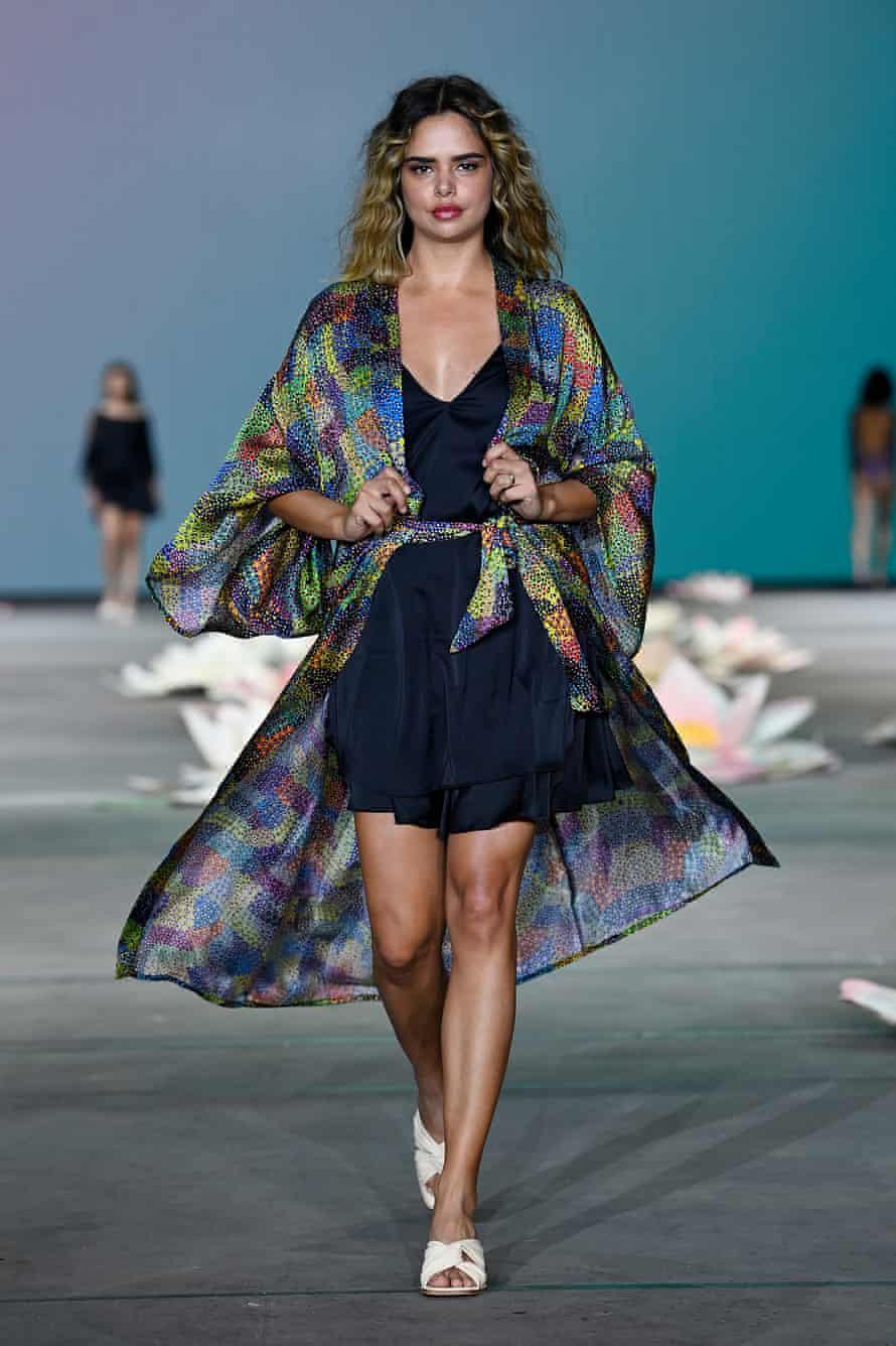 Model Samantha Harris walks the runway in a design by Kirrikin
