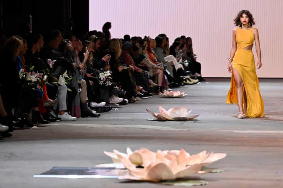 A model walks the runway in a design by MAARA Collective