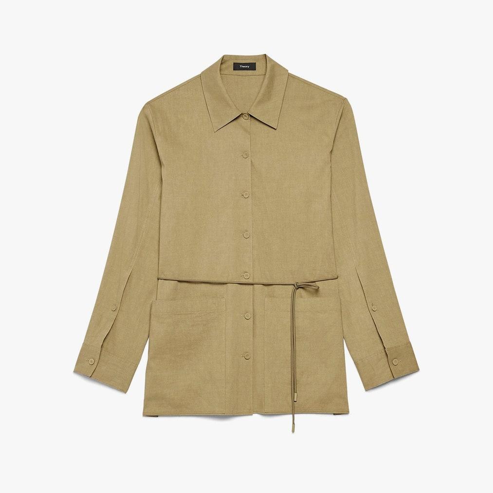 Image may contain: Clothing, Apparel, Overcoat, Coat, Sleeve, Khaki, and Long Sleeve